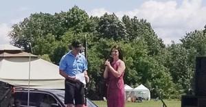 Emcee Trevor Brooks with Livingston Senstion winner Sarah Brown at the Michigan Challenge Balloonfest on Sunday, June 28, 2015.