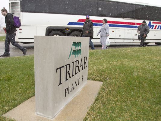 Tribar Manufacturing workers exit a bus that brought them to work at the Howell Township firm.(Photo: Gillis Benedict/Livingston Daily)